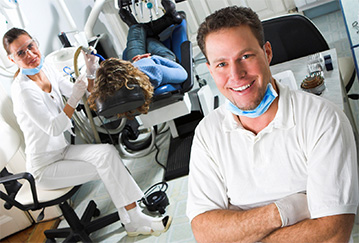 dental assistant cleaning patients teeth